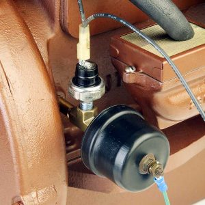 Temperature/oil pressure warning system